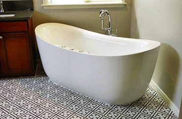 Residential plumbing photo of standalone bathtub